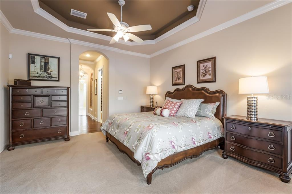 This master bedroom has plush carpeting and his & hers walk-in closets done by California Closets. - Single Family Home for sale at 19432 Newlane Pl, Bradenton, FL 34202 - MLS Number is A4432094