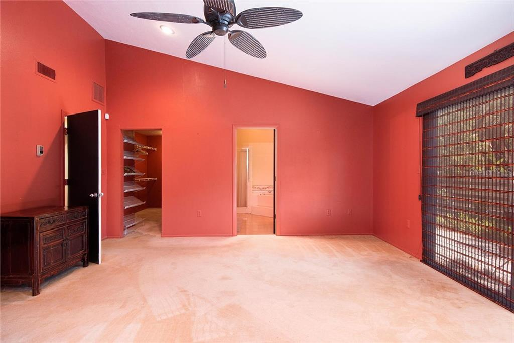 Master Bedroom with Bath and Walk-in Closet. - Single Family Home for sale at 1302 Roberts Bay Ln, Sarasota, FL 34242 - MLS Number is A4433097