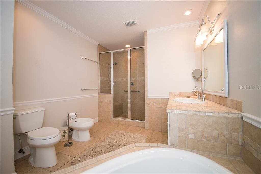 Master Bath on the 3rd Level has whirlpool tub, walk-in shower and bidet - Single Family Home for sale at 2405 Avenue A, Bradenton Beach, FL 34217 - MLS Number is A4433128