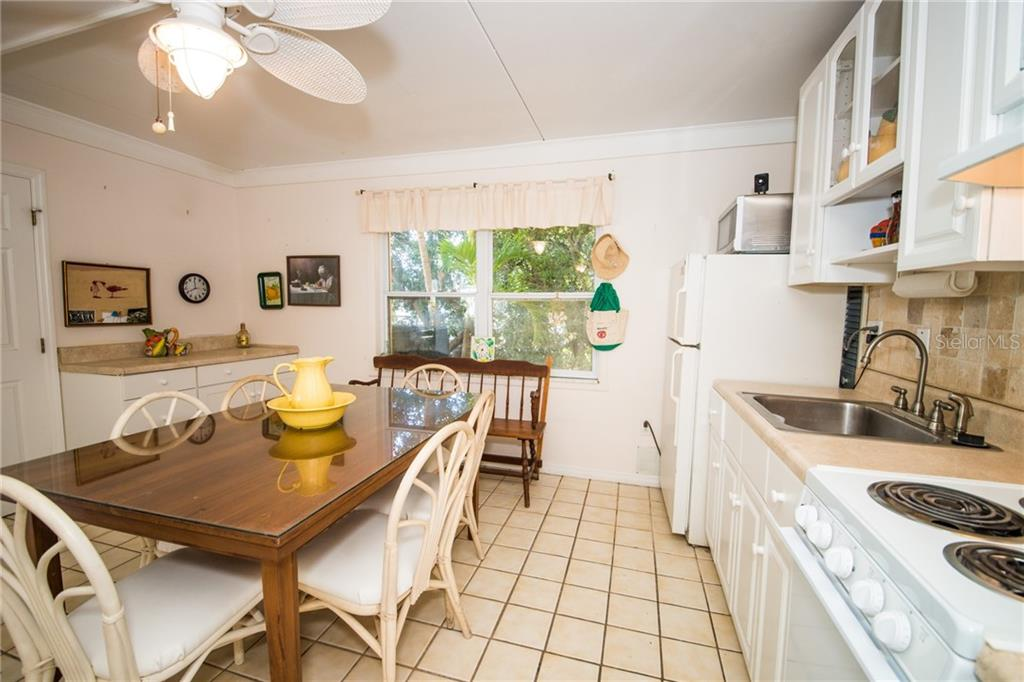 1st Level Kitchen & dining area - Single Family Home for sale at 2405 Avenue A, Bradenton Beach, FL 34217 - MLS Number is A4433128
