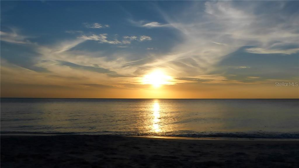 Owner's photo of sunset on beach - Condo for sale at 1212 Benjamin Franklin Dr #1108, Sarasota, FL 34236 - MLS Number is A4433223