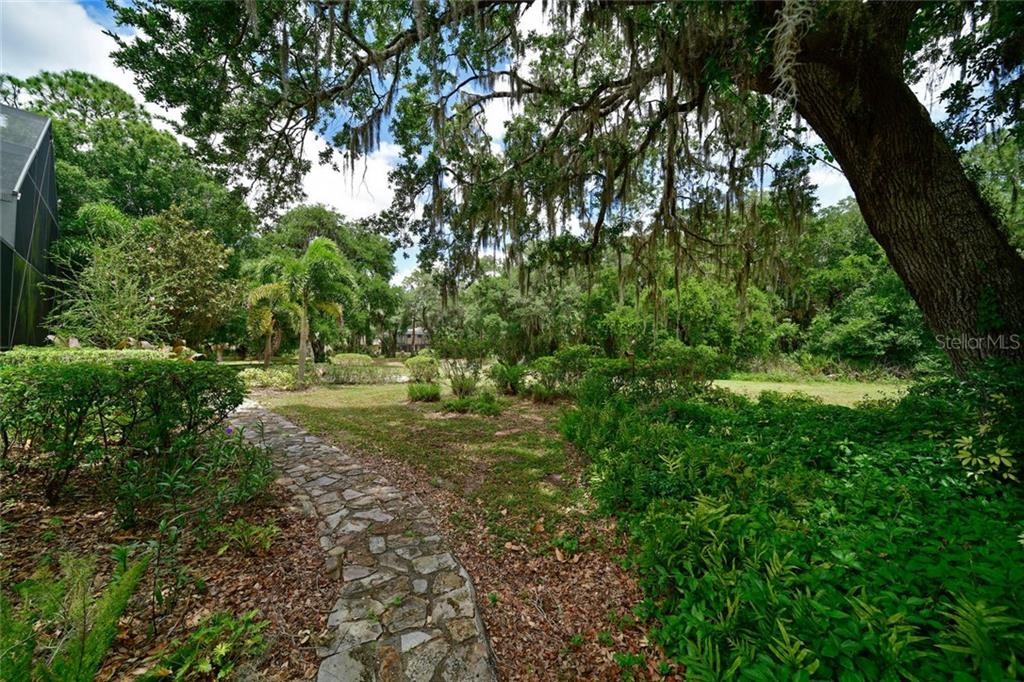 stepping stones to the fire pit - Single Family Home for sale at 13825 18th Pl E, Bradenton, FL 34212 - MLS Number is A4435082
