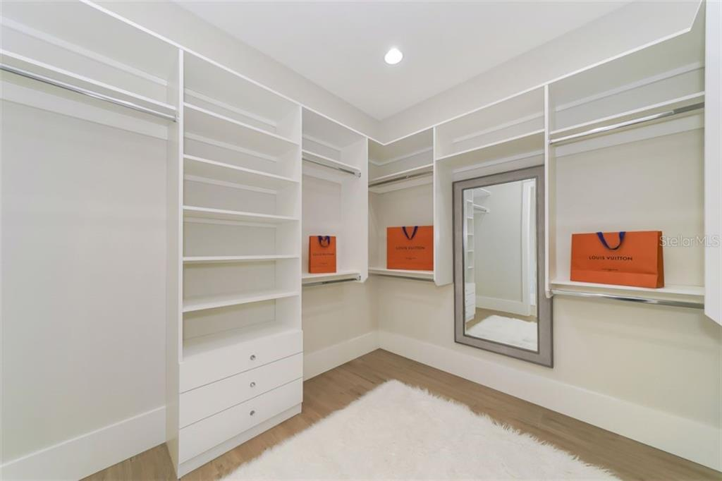 Master Walk -in Closet - Single Family Home for sale at 1643 Stanford Ln, Sarasota, FL 34231 - MLS Number is A4435709