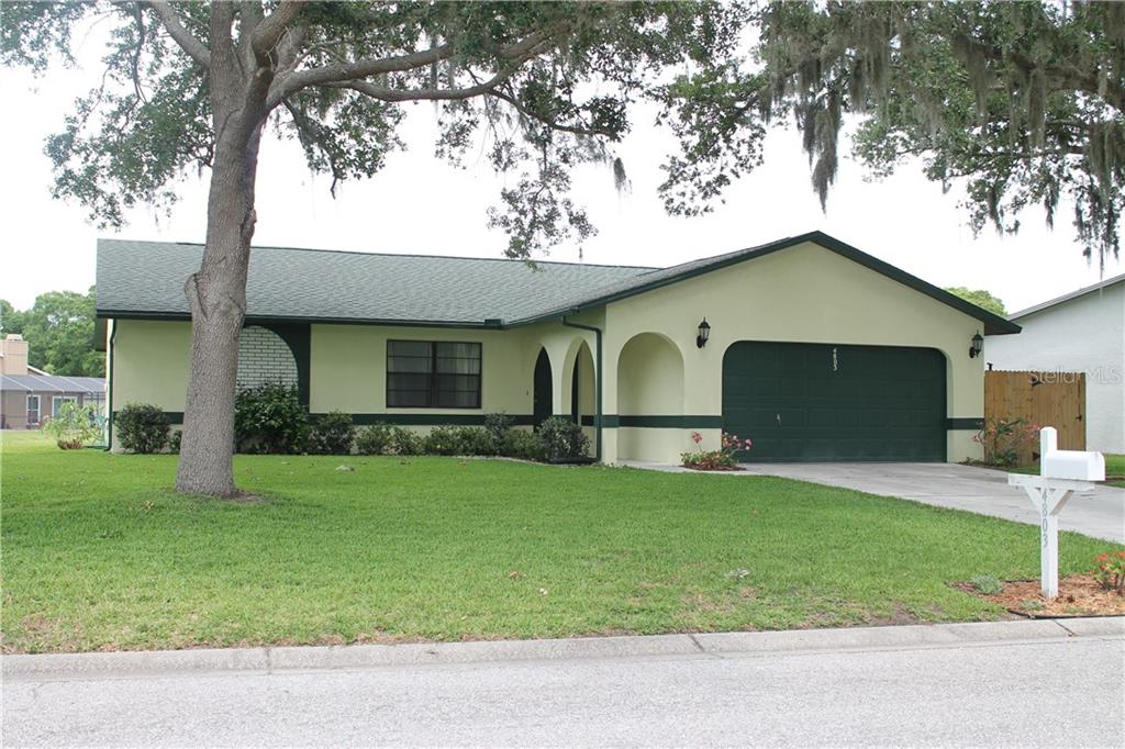 The roof is 2 years old. Hurricane straps were also added for that extra sense of security also to help lower your  Home Owners Insurance.   The outside of the home was painted after the roof install. - Single Family Home for sale at 4803 Glenbrooke Dr, Sarasota, FL 34243 - MLS Number is A4435920