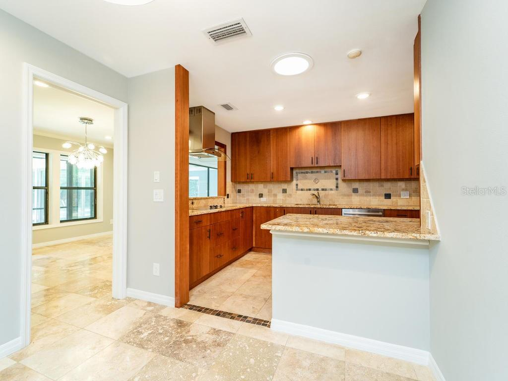 Kitchen with stainless Steel Appliances. - Single Family Home for sale at 4773 Pine Harrier Dr, Sarasota, FL 34231 - MLS Number is A4436182