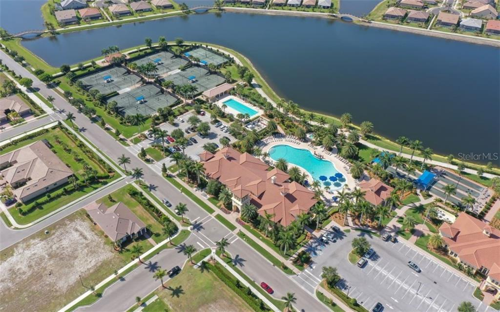 Clubhouse, resort pool, lap pool, tennis courts - Single Family Home for sale at 13337 Pacchio St, Venice, FL 34293 - MLS Number is A4437569