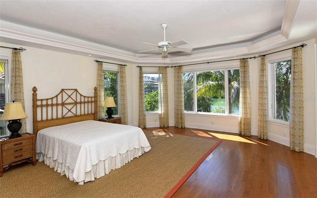Guest bedroom suite - Single Family Home for sale at 65 Lighthouse Point Dr, Longboat Key, FL 34228 - MLS Number is A4438181