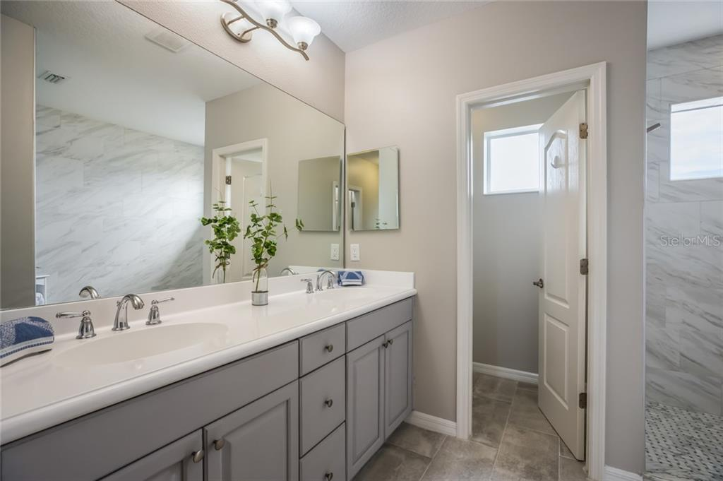 Master bath - Single Family Home for sale at 12255 Longview Lake Cir, Lakewood Ranch, FL 34211 - MLS Number is A4439342