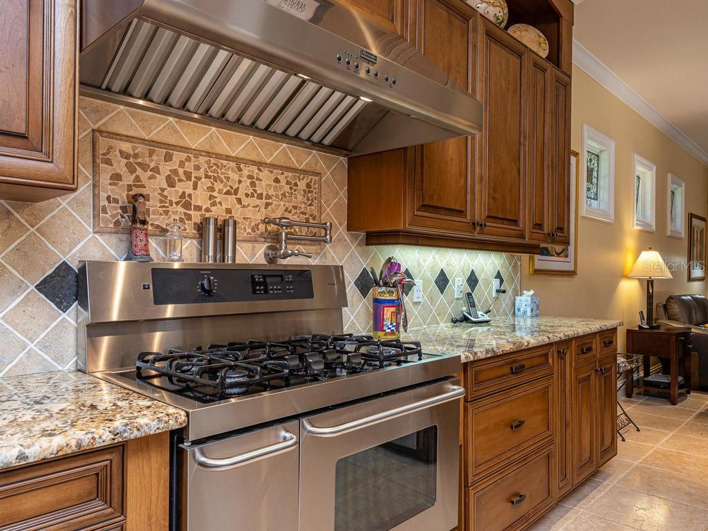 Pot Filler Faucet, Gas Range, 3 ovens and a warming tray - Single Family Home for sale at 158 Puesta Del Sol, Osprey, FL 34229 - MLS Number is A4439362