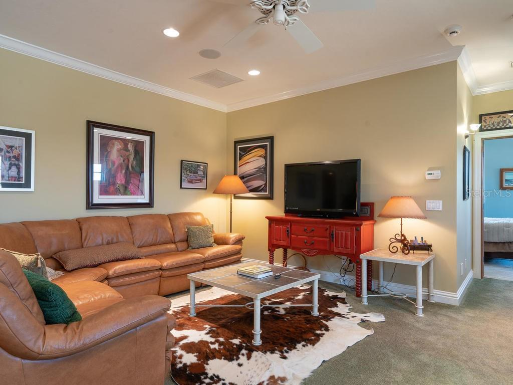 Great room TV area, wet bar to the right - Single Family Home for sale at 158 Puesta Del Sol, Osprey, FL 34229 - MLS Number is A4439362