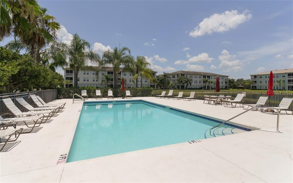 Heated community pool adjacent to clubhouse. - Condo for sale at 200 San Lino Cir #233, Venice, FL 34292 - MLS Number is A4440138