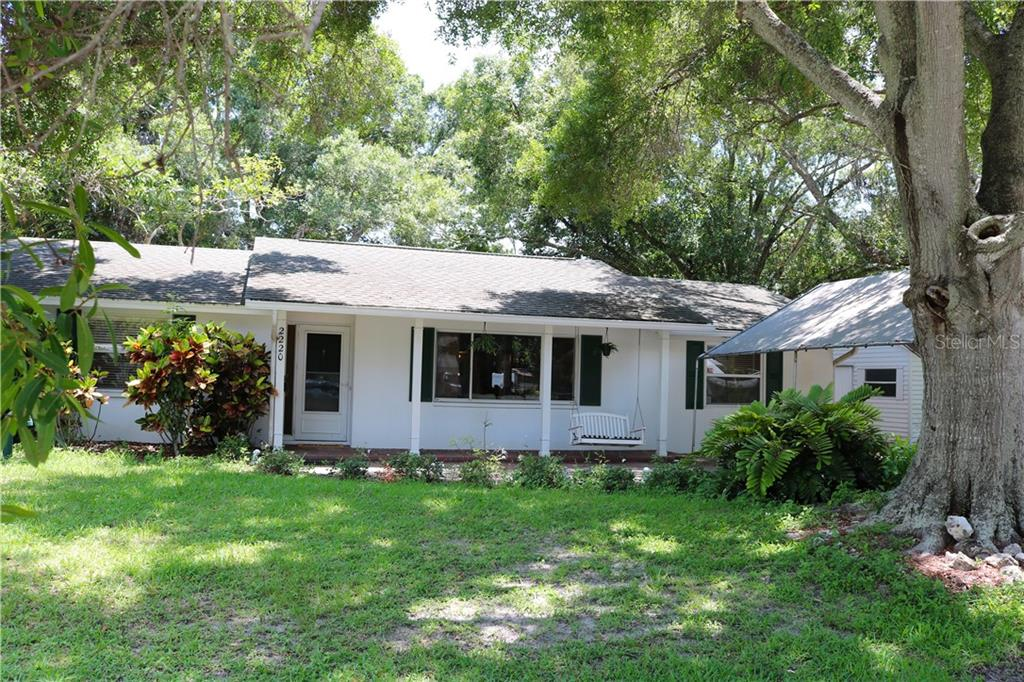 Nestled almost at the end of a dead end street, under the lush canopy of oaks. - Single Family Home for sale at 2220 Pine Ter, Sarasota, FL 34231 - MLS Number is A4440562