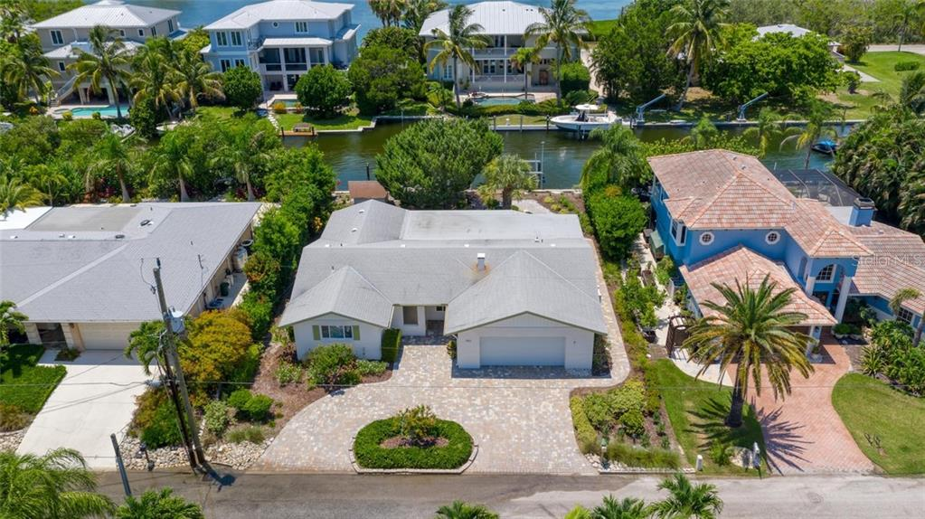 This fabulous Florida home sits on a nice wide canal on the quaint north end of Longboat Key - Single Family Home for sale at 701 Norton St, Longboat Key, FL 34228 - MLS Number is A4440596