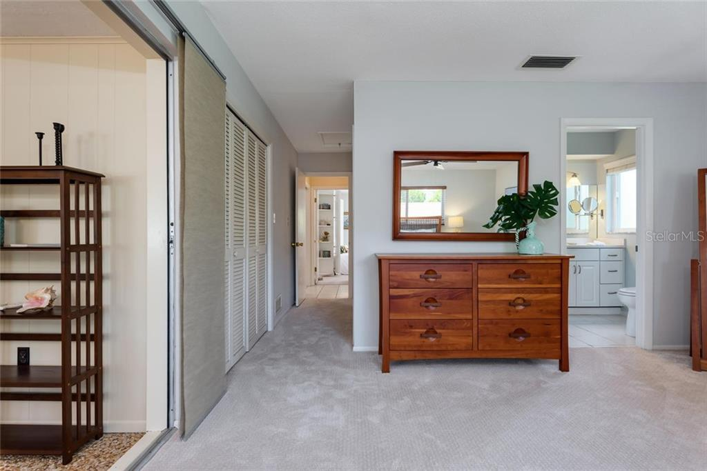 The large master bedroom overlooks the canal as well. - Single Family Home for sale at 701 Norton St, Longboat Key, FL 34228 - MLS Number is A4440596
