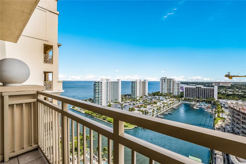 Gorgeous sunsets from the large balcony off the living room and library! - Condo for sale at 1111 Ritz Carlton Dr #1704, Sarasota, FL 34236 - MLS Number is A4442192