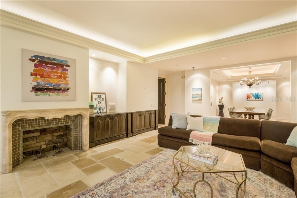 The fireplace in the living room is electric. - Condo for sale at 1111 Ritz Carlton Dr #1704, Sarasota, FL 34236 - MLS Number is A4442192