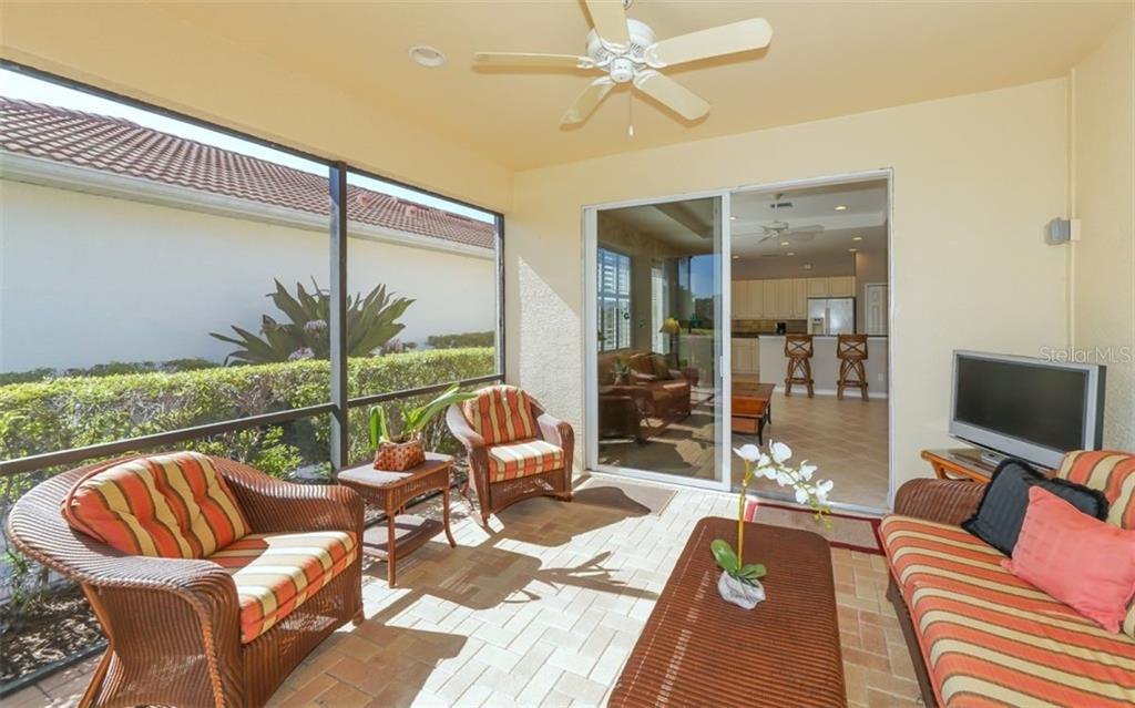 Nice covered lanai with electric roll down hurricane shutters. - Single Family Home for sale at 114 Padova Way #52, North Venice, FL 34275 - MLS Number is A4442496