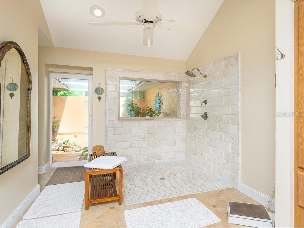 Walk-in shower in Master ensuite - Single Family Home for sale at 1716 Bayshore Dr, Englewood, FL 34223 - MLS Number is A4445961