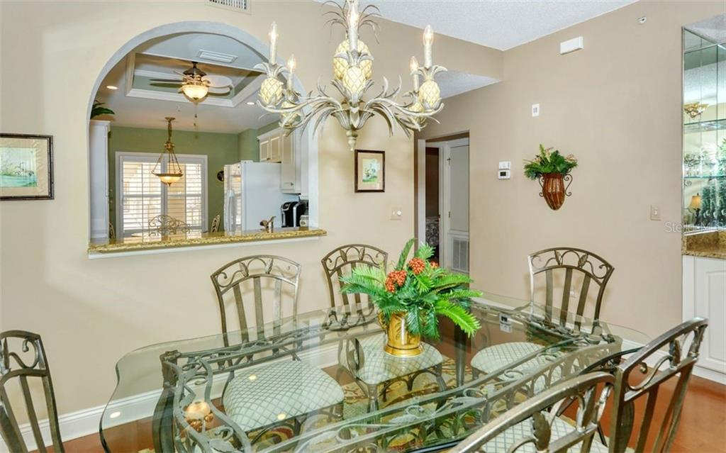 Large pass-through from kitchen to dining room. - Condo for sale at 9620 Club South Cir #5202, Sarasota, FL 34238 - MLS Number is A4450015