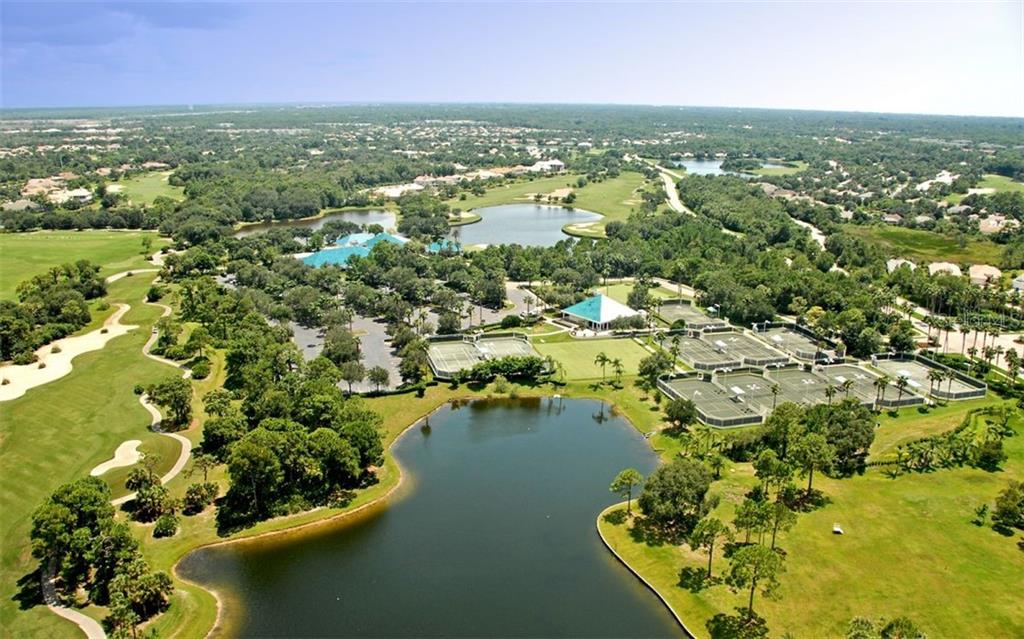 The course, surrounded by natural woodlands & native habitat, was designed by Ron Garl - Single Family Home for sale at 6620 Hunter Combe Xing, University Park, FL 34201 - MLS Number is A4450282