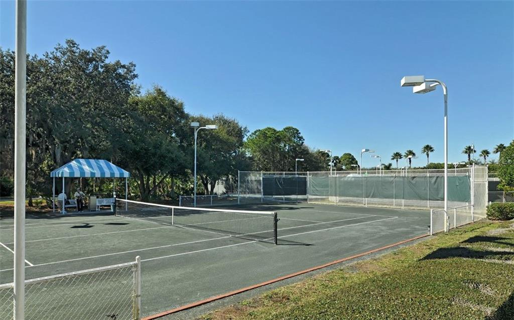 There are 11 lighted Har-Tru tennis courts and expert tennis instruction is available - Single Family Home for sale at 6620 Hunter Combe Xing, University Park, FL 34201 - MLS Number is A4450282