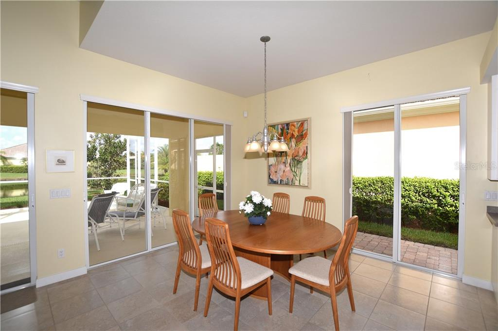 Dining area with easy access to the screened lanai and nearby patio perfect for grilling. - Single Family Home for sale at 5799 Benevento Dr, Sarasota, FL 34238 - MLS Number is A4450677