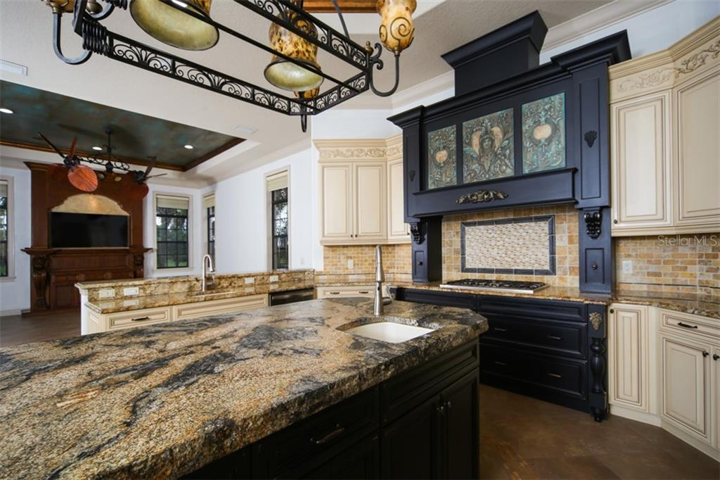 Prep sink in kitchen island with granite countertop - Single Family Home for sale at 15212 Linn Park Ter, Lakewood Ranch, FL 34202 - MLS Number is A4450793