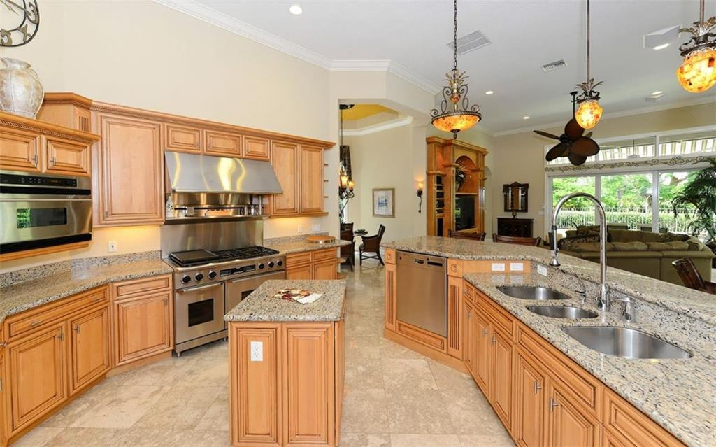 The chef in the family will love the professional style kitchen with gas range, prep sinks, center prep island and plenty of counter space. - Single Family Home for sale at 586 N Macewen Dr, Osprey, FL 34229 - MLS Number is A4451482