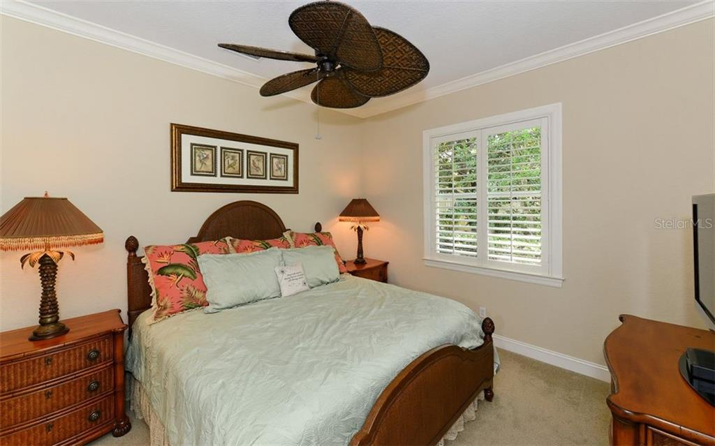 Bedroom 2 - Single Family Home for sale at 586 N Macewen Dr, Osprey, FL 34229 - MLS Number is A4451482