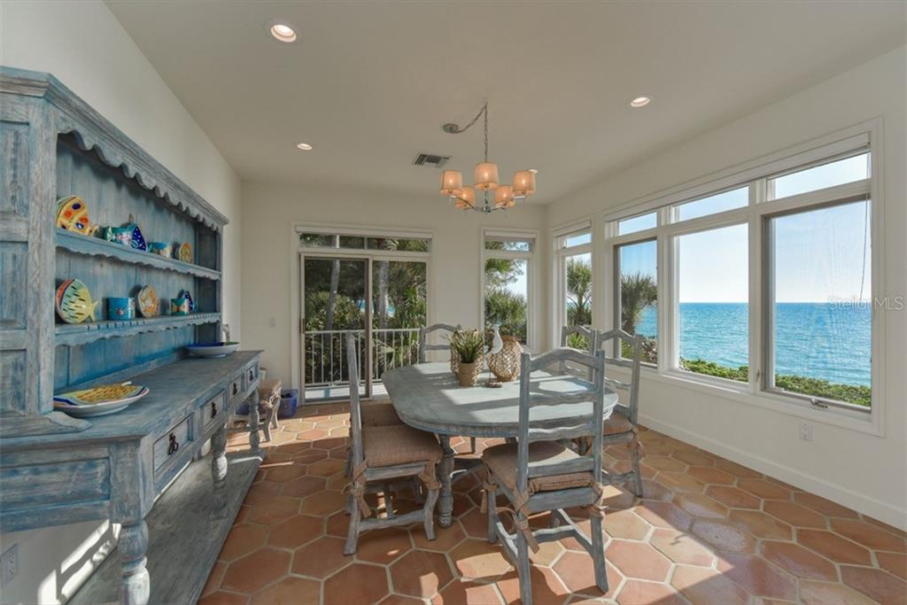 Large dining area with a stairway to sun and fun. Imagine coffee or cocktails with inspiring views. - Single Family Home for sale at 1027 N Casey Key Rd, Osprey, FL 34229 - MLS Number is A4451976