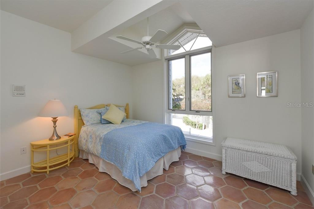 Light and airy bedroom 4. - Single Family Home for sale at 1027 N Casey Key Rd, Osprey, FL 34229 - MLS Number is A4451976