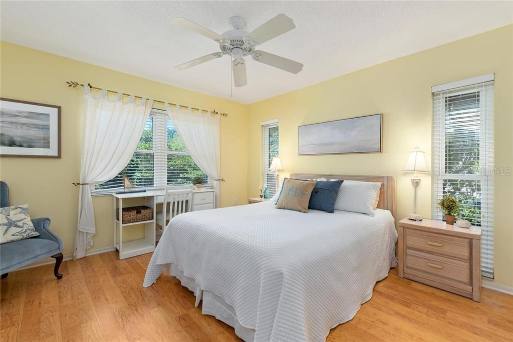 The light filled master bedroom - Condo for sale at 4307 Gulf Dr #209, Holmes Beach, FL 34217 - MLS Number is A4452656