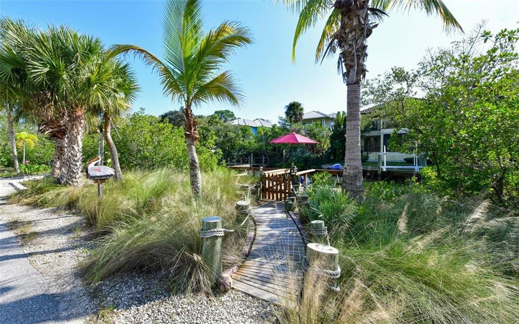 Florida Friendly landscaped shoreline with walk way to boat dock - Single Family Home for sale at 623 Avenida Del Norte, Sarasota, FL 34242 - MLS Number is A4454692