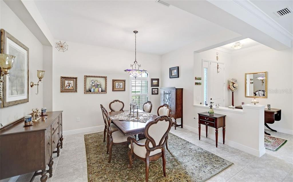 formal dining room - Single Family Home for sale at 8260 Larkspur Cir, Sarasota, FL 34241 - MLS Number is A4455087