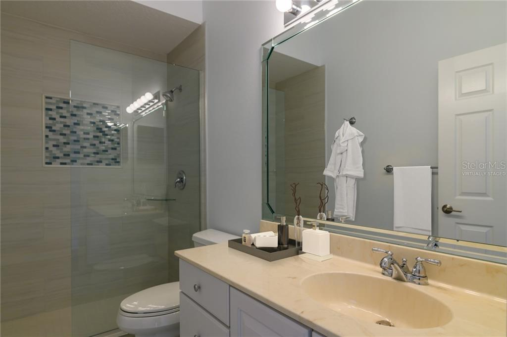 2nd bathroom Virtually Staged - Villa for sale at 4560 Samoset Dr, Sarasota, FL 34241 - MLS Number is A4455487