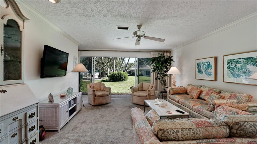 PRETTY VIEWS OF LUSHLY LANDSCAPED YARD & HEATED POOL (ONE OF 2). THIS VILLA LIVES LIKE A HOUSE, SPACIOUS, LOTS OF CLOSETS, PRIVATE FEELING, NO ONE ABOVE YOU ! - Condo for sale at 6700 Gulf Of Mexico Dr #116, Longboat Key, FL 34228 - MLS Number is A4456442