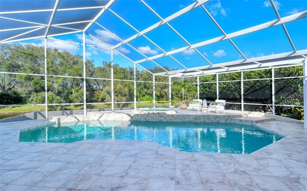 Salt water pool and hot tub propane heated. - Single Family Home for sale at 4177 Escondito Cir, Sarasota, FL 34238 - MLS Number is A4456531