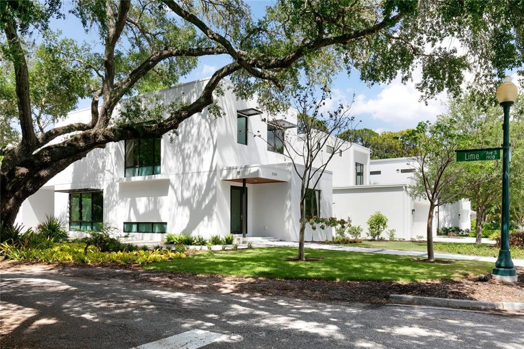 Corner lot accented with this stunning Grand Oak. - Single Family Home for sale at 2301 Hyde Park St, Sarasota, FL 34239 - MLS Number is A4456649