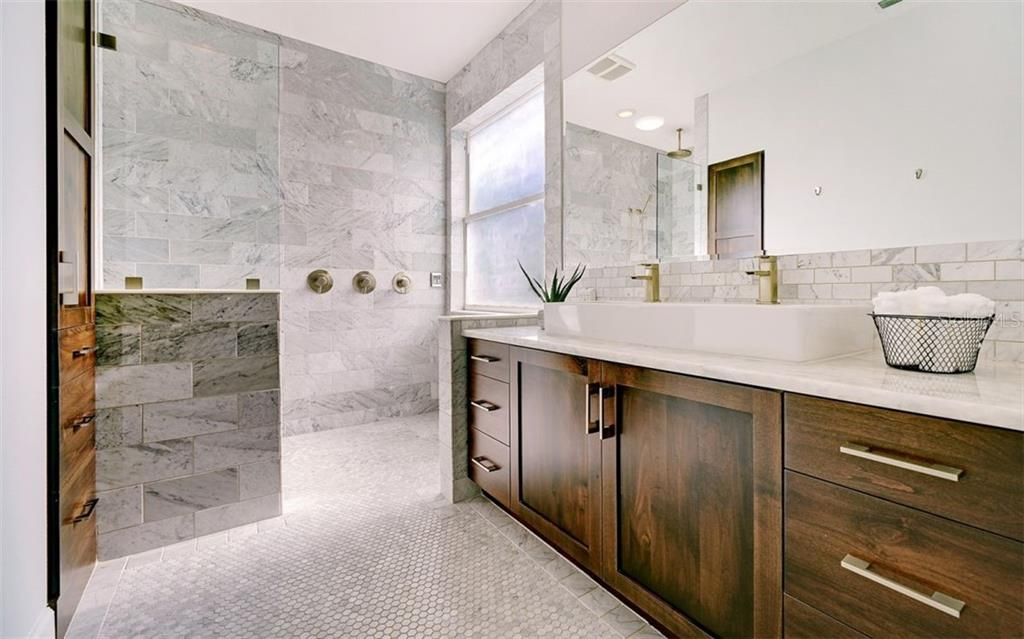Master bath with a luxurious Roman shower with 3 shower heads - Single Family Home for sale at 6510 Field Sparrow Gln, Lakewood Ranch, FL 34202 - MLS Number is A4457243