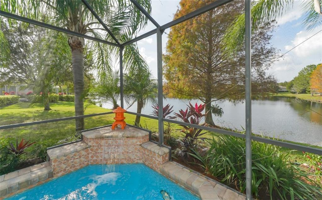 The sound of a waterfall helps relaxation - Single Family Home for sale at 6510 Field Sparrow Gln, Lakewood Ranch, FL 34202 - MLS Number is A4457243