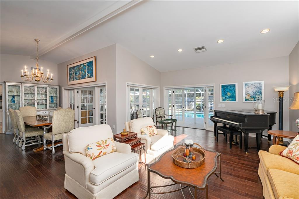 Gorgeous wide planked Walnut hardwood floors in dining and living rooms. - Single Family Home for sale at 4557 Camino Real, Sarasota, FL 34231 - MLS Number is A4457740