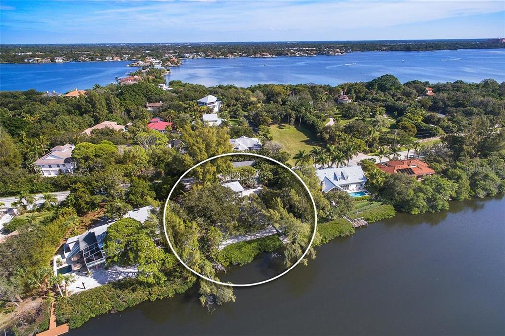 Single Family Home for sale at 7676 Midnight Pass Rd, Sarasota, FL 34242 - MLS Number is A4457985