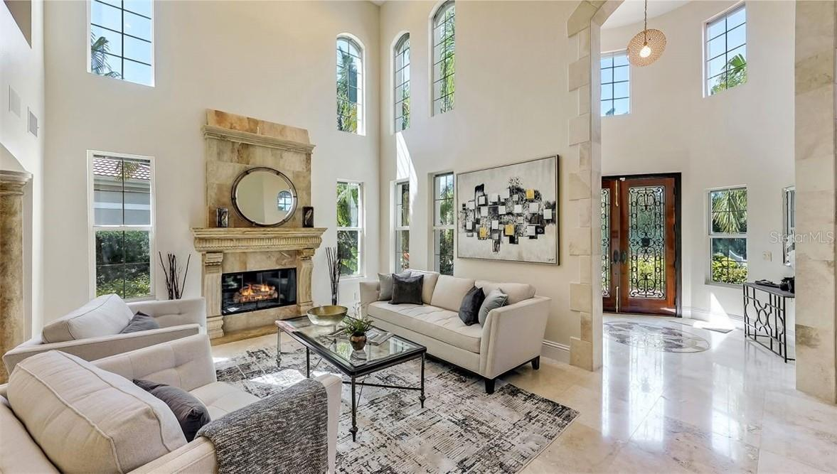 Living Room has been virtually staged. - Single Family Home for sale at 5372 Sandhamn Pl, Longboat Key, FL 34228 - MLS Number is A4458496