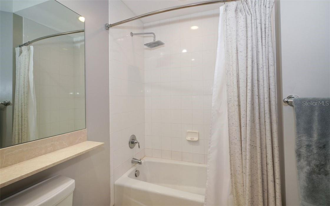 Ensuite bath with tub and rain shower - Condo for sale at 100 Central Ave #A304, Sarasota, FL 34236 - MLS Number is A4458873