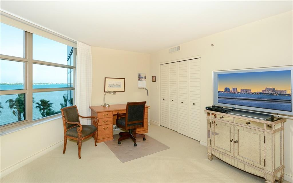 Guest bedroom with view - Condo for sale at 888 Blvd Of The Arts #705, Sarasota, FL 34236 - MLS Number is A4461143
