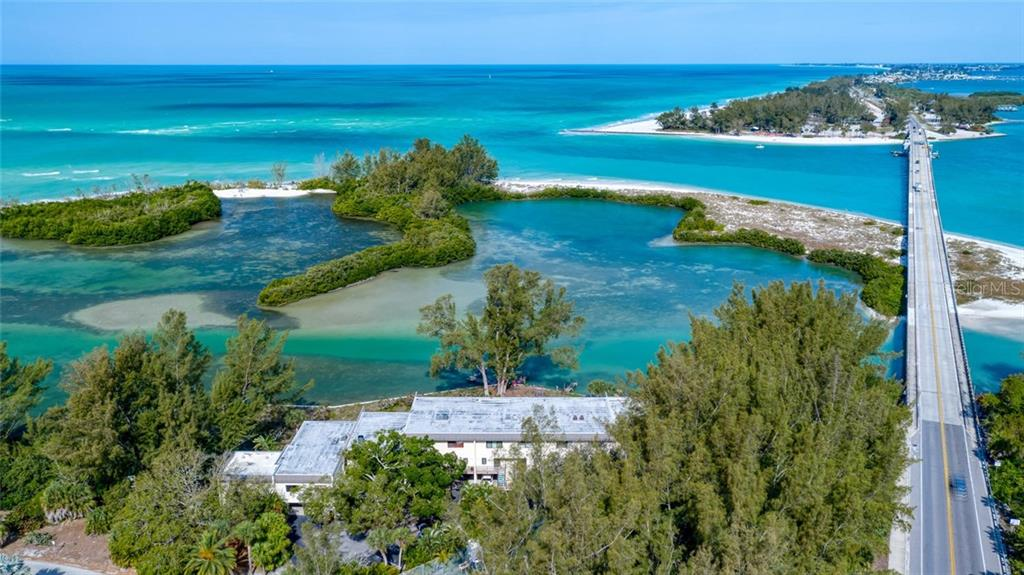 What an amazing location! 490 Northgate sits in a secluded and absolutely gorgeous spot on the north end of Longboat Key. With a view like this you may never want to leave home! - Condo for sale at 490 N Shore Rd #7, Longboat Key, FL 34228 - MLS Number is A4461297
