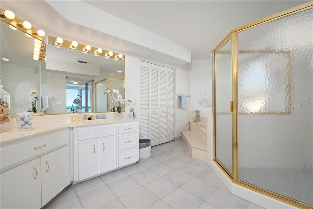 Master bath with double vanity, soaking tub and walk in shower - Single Family Home for sale at 710 S Bay Blvd, Anna Maria, FL 34216 - MLS Number is A4461640