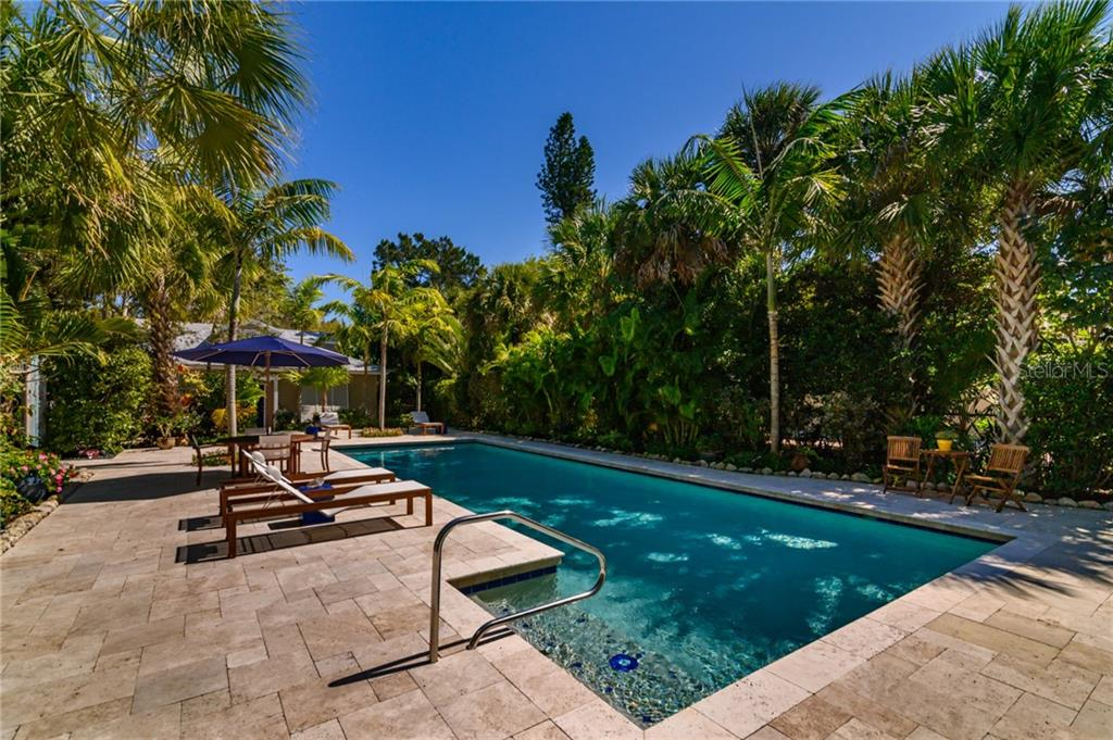 Salt Water Lap Pool, 46'x16, Looking East to GuestHouse - Single Family Home for sale at 7340 Point Of Rocks Rd, Sarasota, FL 34242 - MLS Number is A4461841