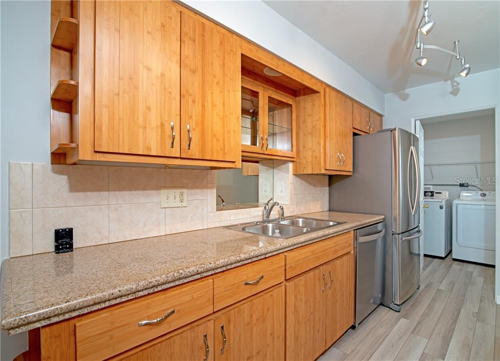 Custom Bamboo Style Cabinetry with Granite countertops and tile backsplash. - Single Family Home for sale at 5057 Bell Meade Dr, Sarasota, FL 34232 - MLS Number is A4461883