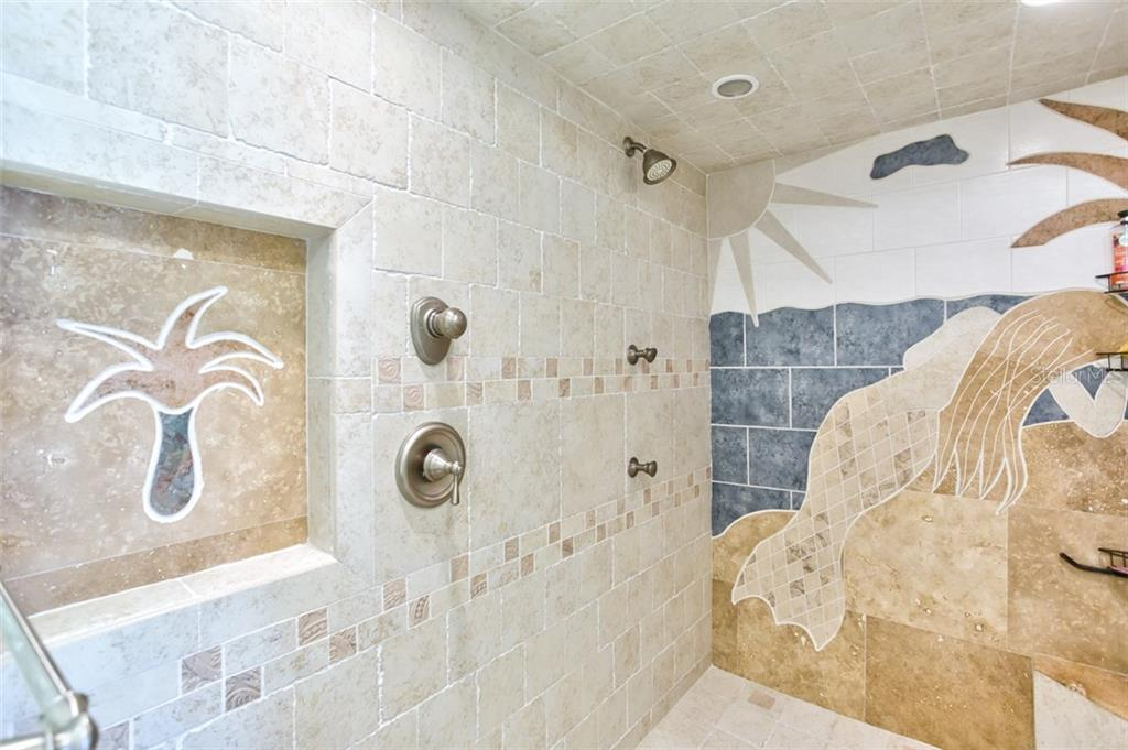 Wake up to the beautiful mosaic of the mermaid and the palm tree in your shower - Condo for sale at 5880 Midnight Pass Rd #911, Sarasota, FL 34242 - MLS Number is A4462559